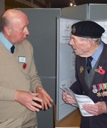 WMT Trustee David Seymour discuss the work of the Trust with a visitor to the stall © Chris Moreton